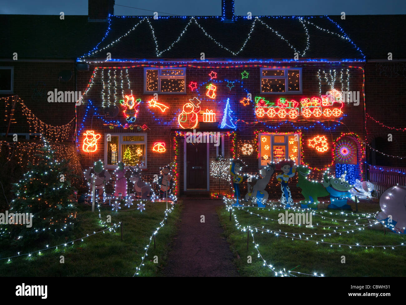 exterior of a house lit up with christmas lights at dusk home property illuminated xmas decorations at night