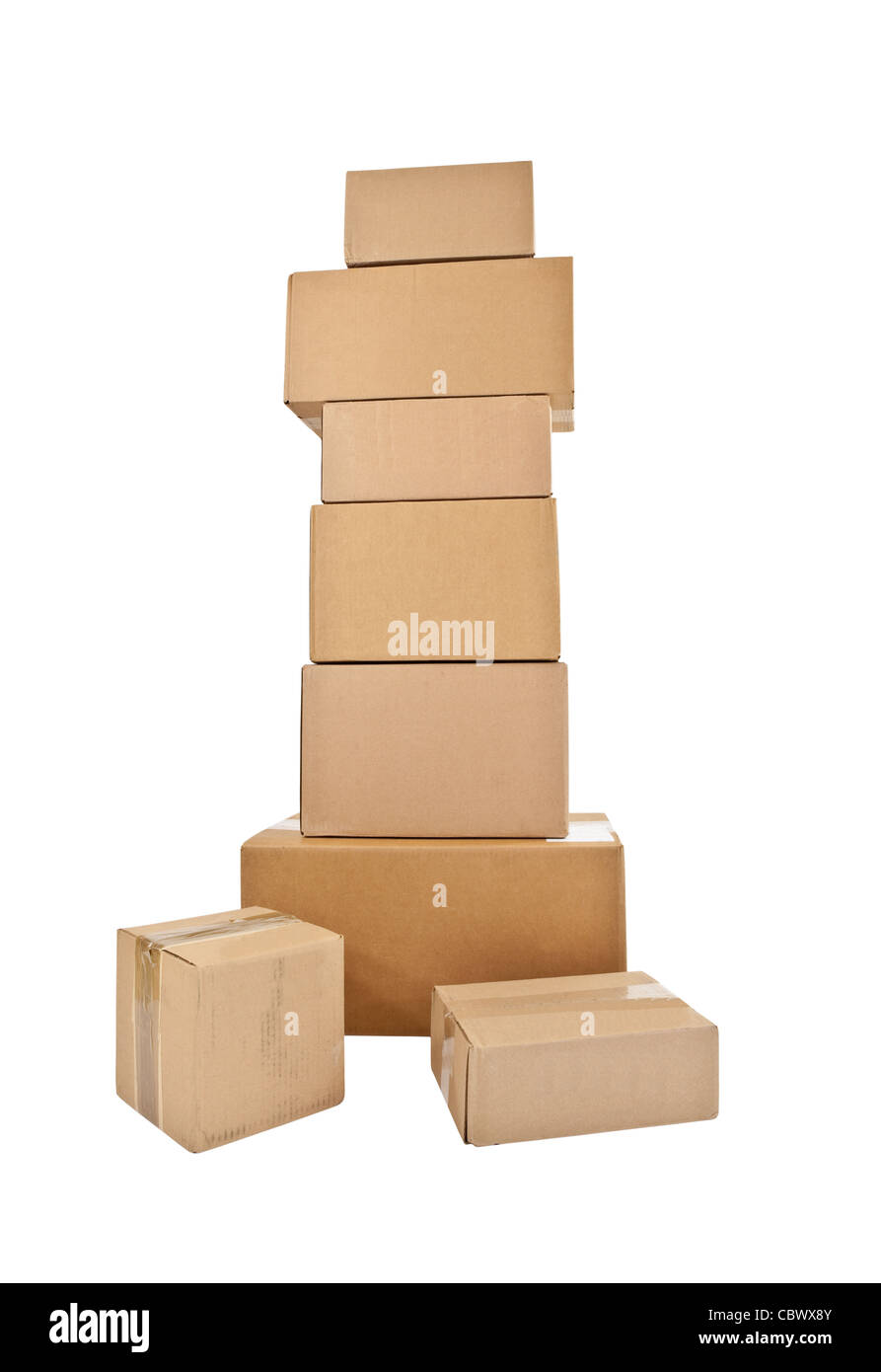 Tall stack of shipping boxes isolated on white. - Stock Image
