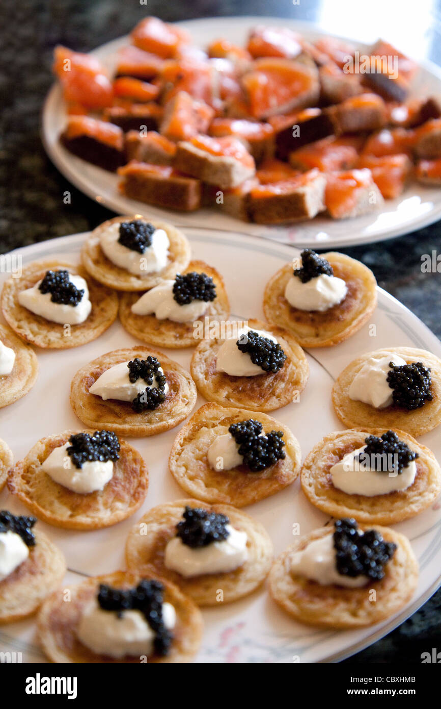blinis with sour cream and caviar with smoked salmon on bread , Christmas food UK - Stock Image
