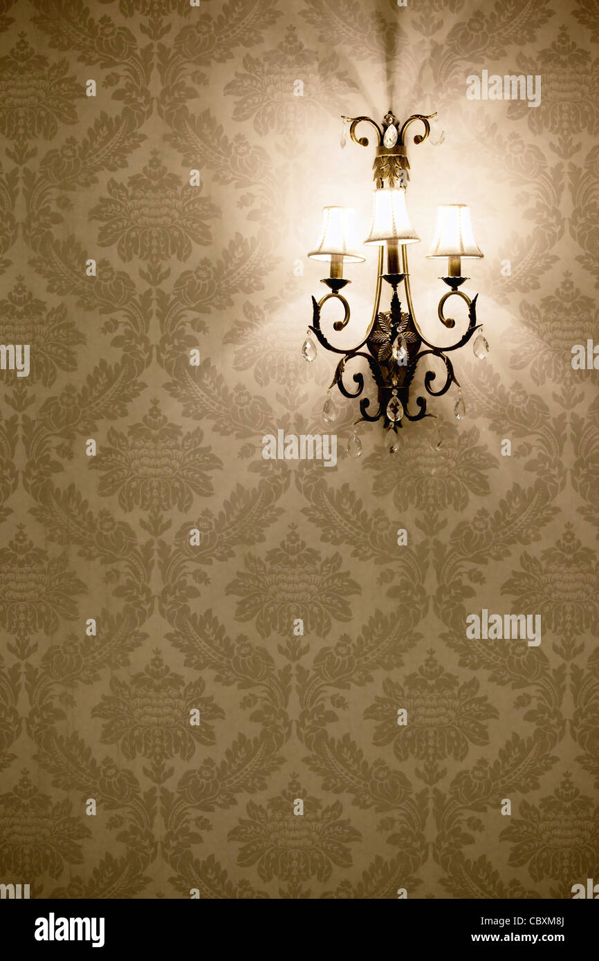 Stylish lamp on the wallpaper - Stock Image