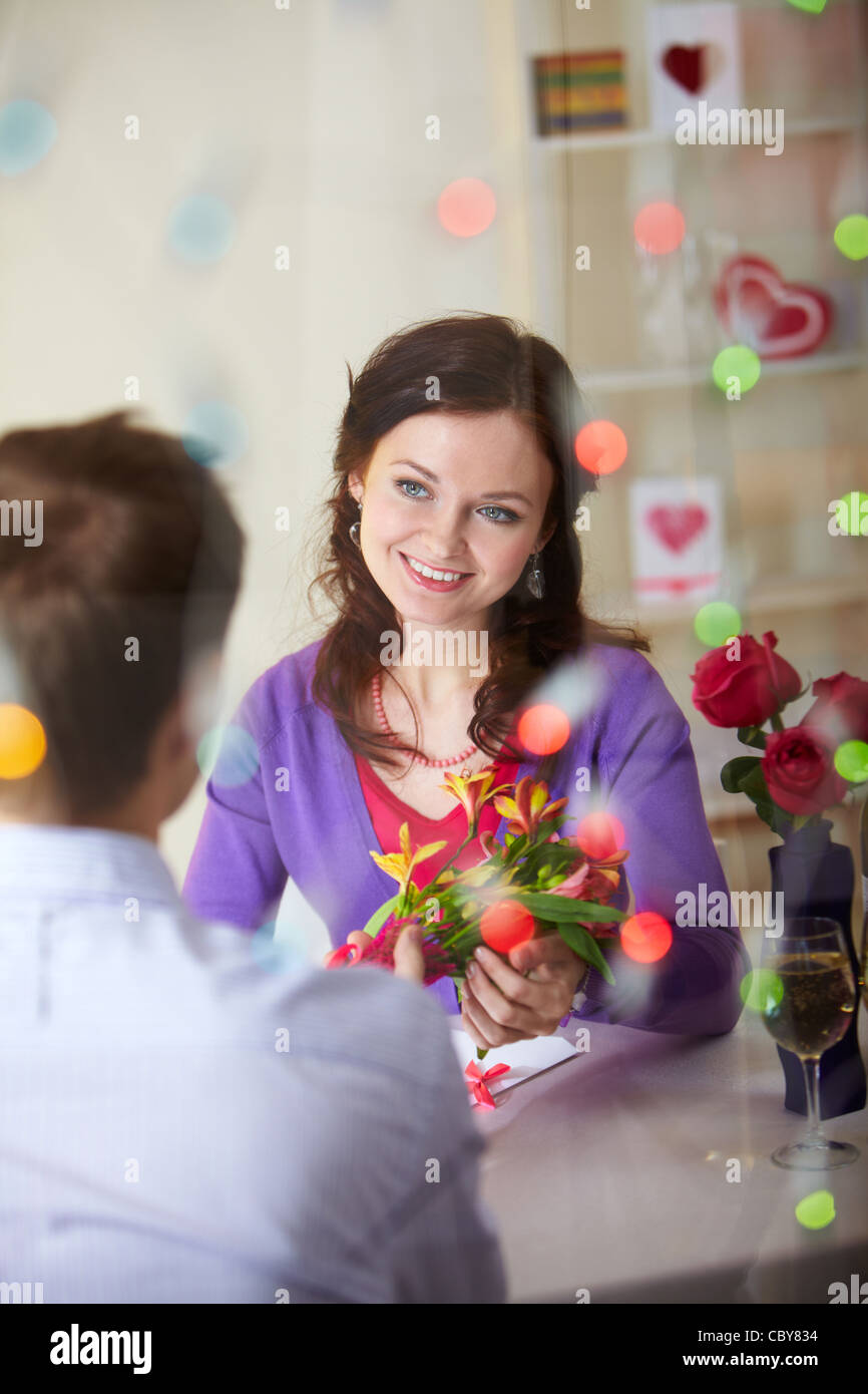A young man giving bouquet of flowers to pretty girlfriend stock a young man giving bouquet of flowers to pretty girlfriend mightylinksfo