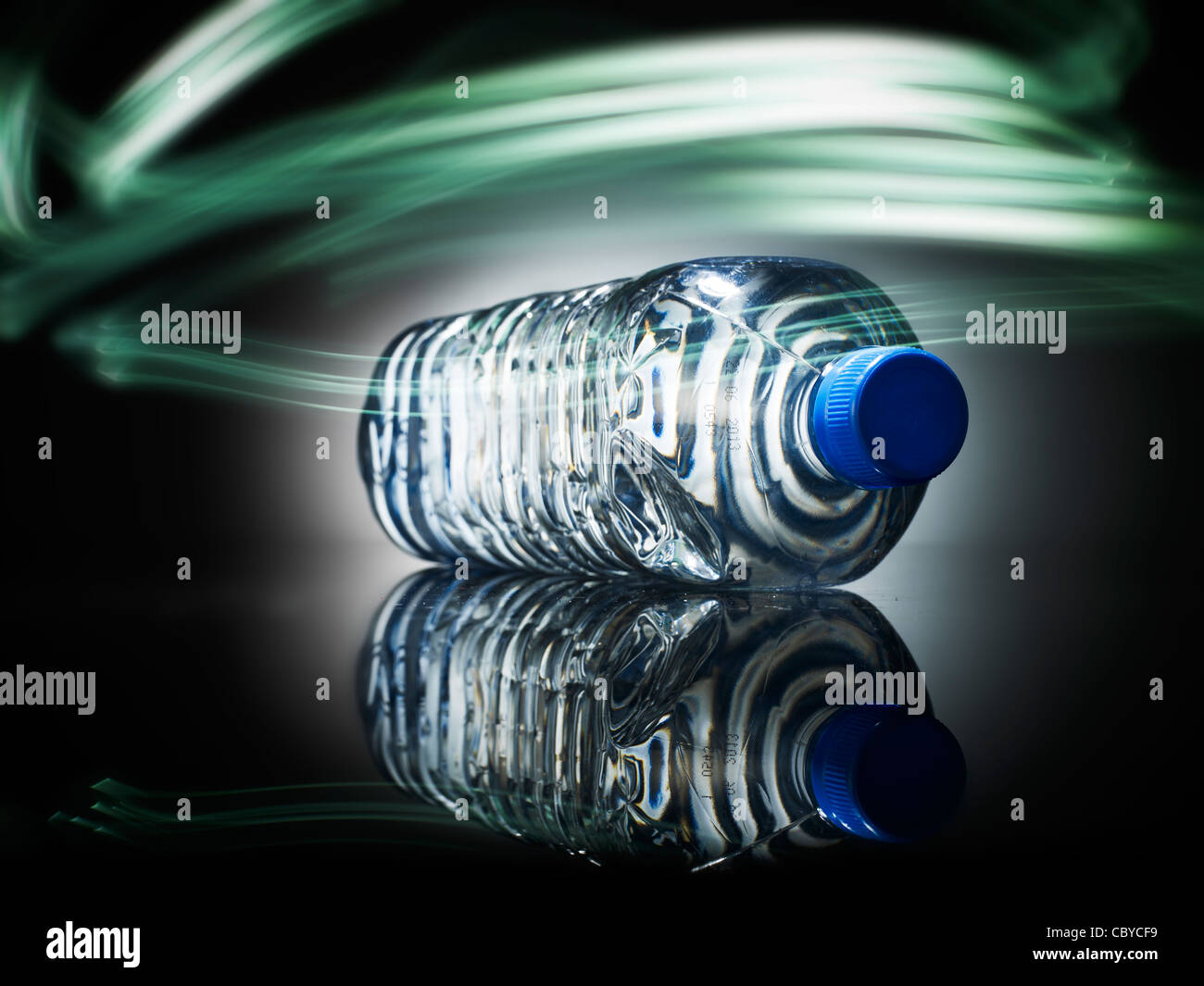Bottled water with light painting - Stock Image