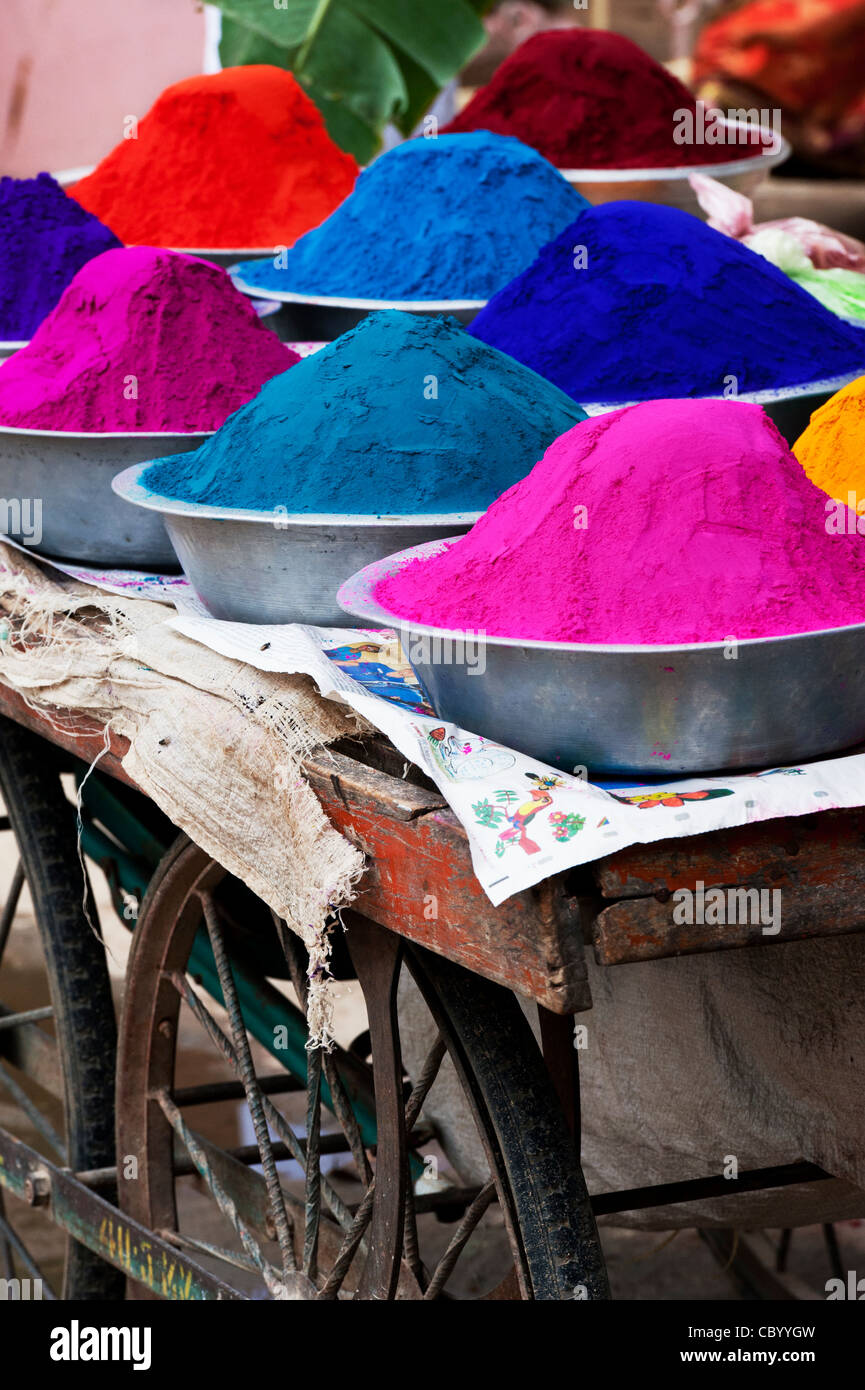 Coloured Indian powder in metal bowls used for making rangoli designs at festivals - Stock Image