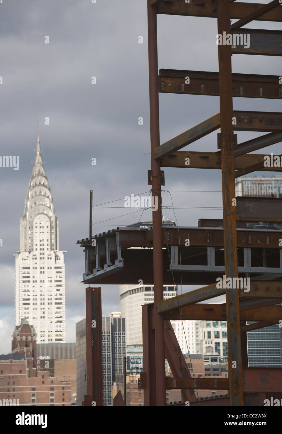 USA, New York State, New York City, Construction site and Chrysler building in background - Stock Image