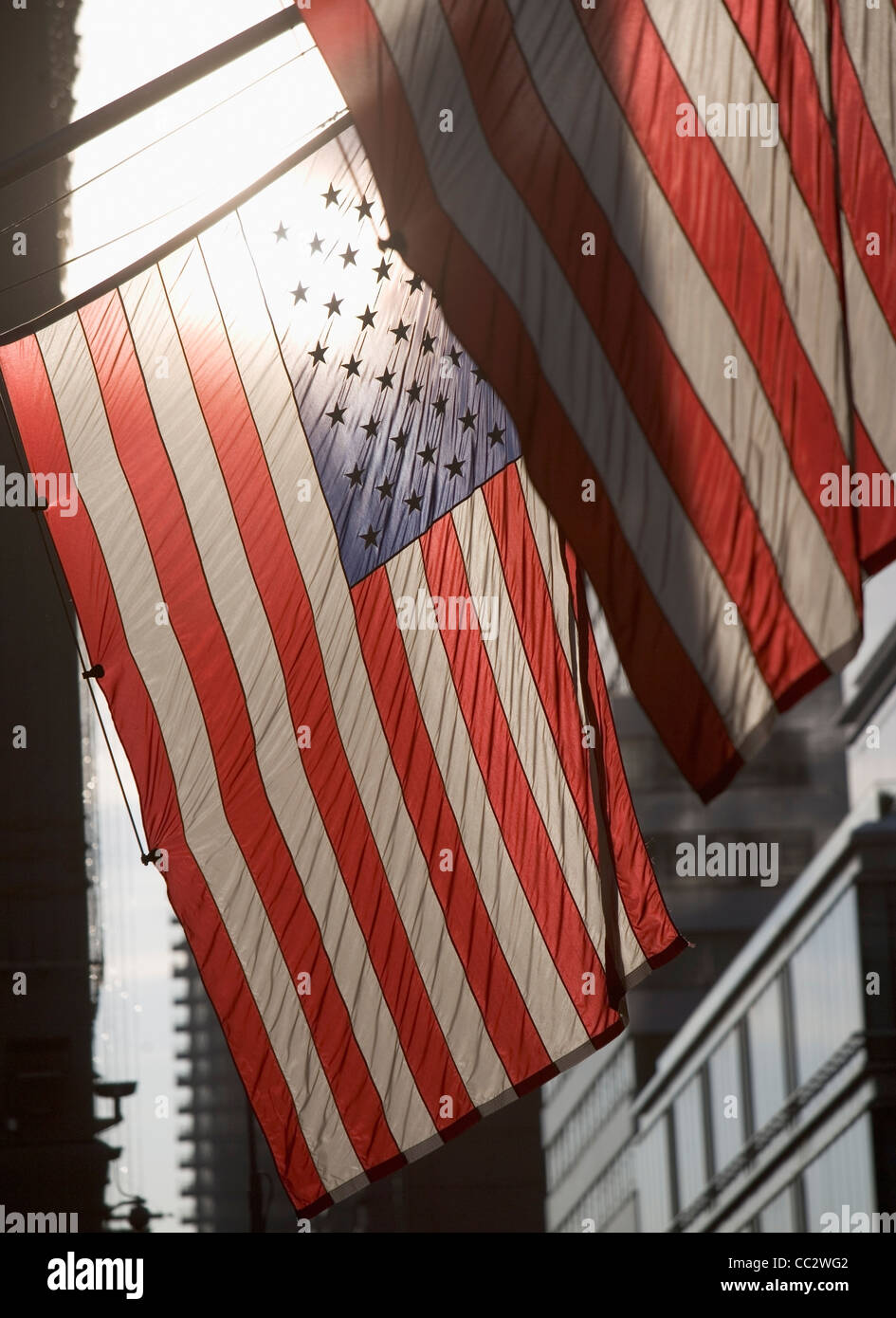 USA, New York City, Backlit American flags - Stock Image