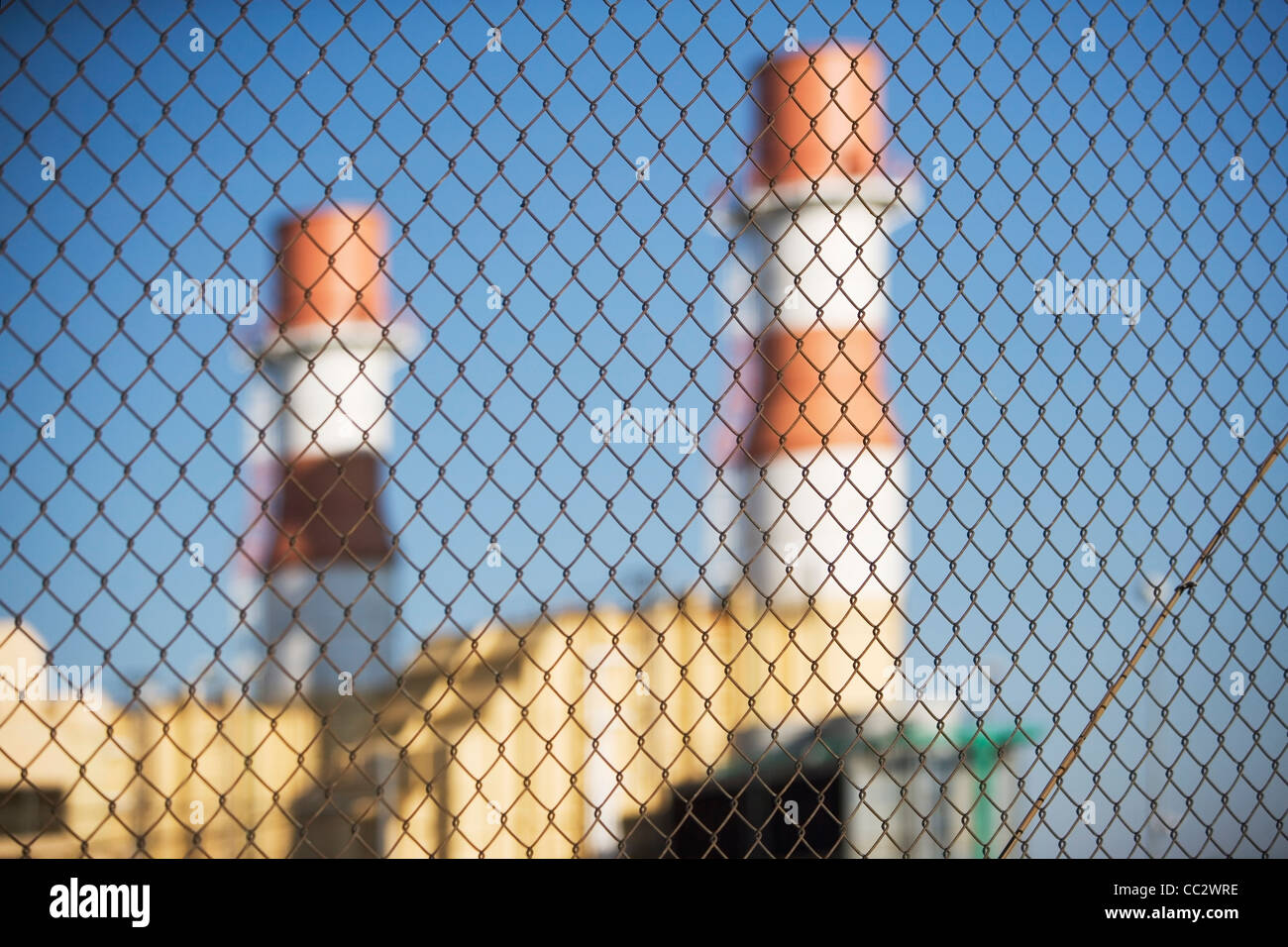 USA, New York City, Industrial plant behind wire mesh fence - Stock Image