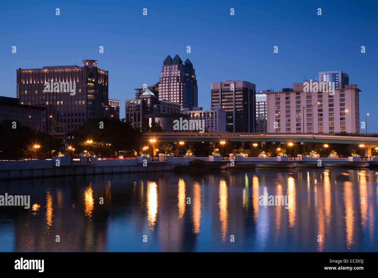 USA, Florida, Orlando, skyline from Lake Lucerne, dusk - Stock Image