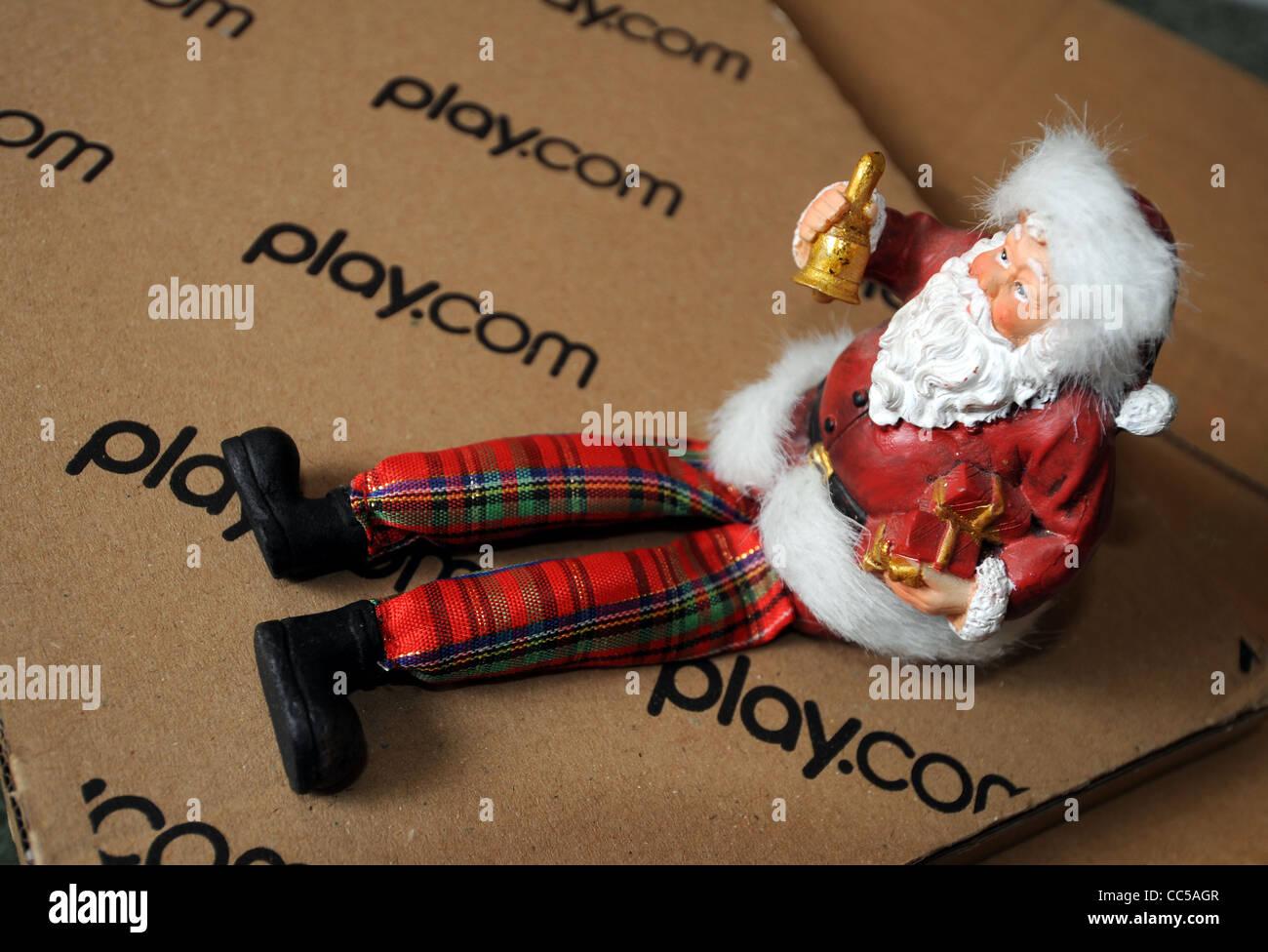 Online shopping at Play.com at Christmas, UK - Stock Image