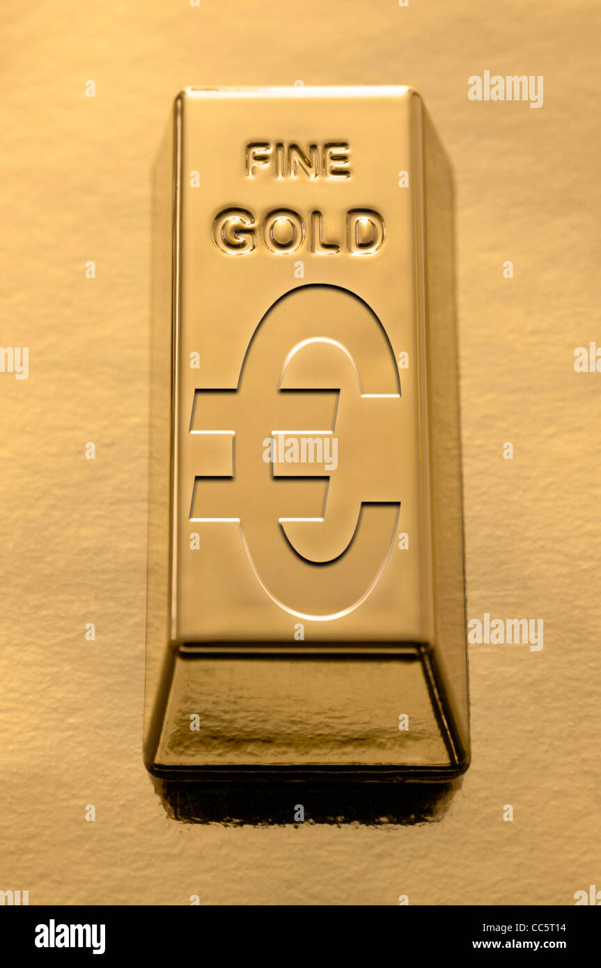Gold Bar with a Euro symbol embossed on it on a gold background - Stock Image