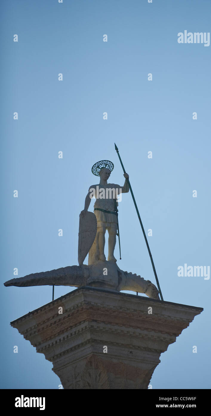 Molo Column of San Teodoro and the mythical dragon-like beast - Stock Image