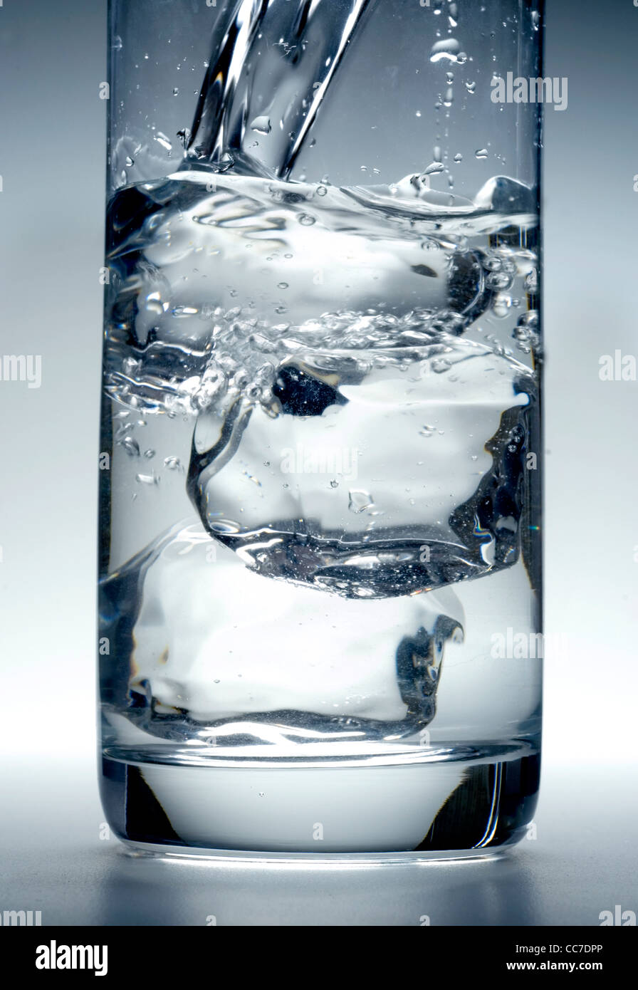 glass of water with ice cubes - Stock Image