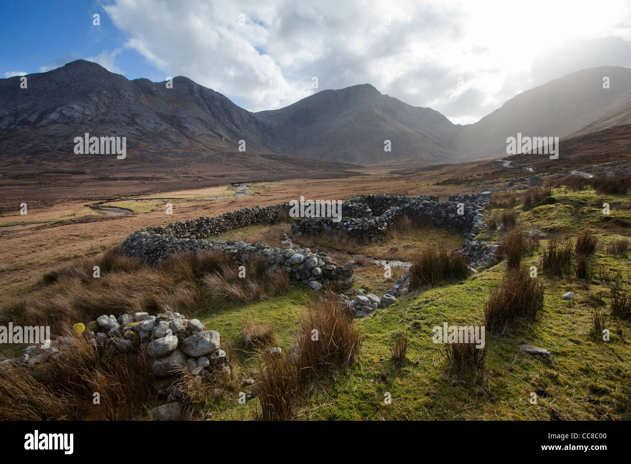 Stone farm enclosures in Gleninagh, with the Twelve Bens behind, Connemara, County Galway, Ireland. - Stock Image
