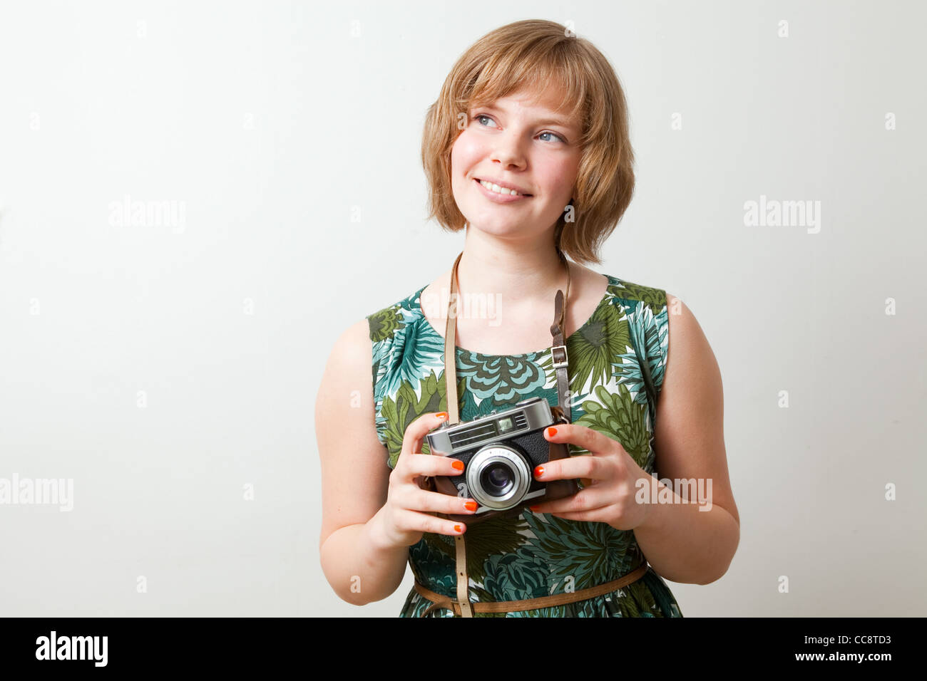Young woman holding an old vintage camera - Stock Image