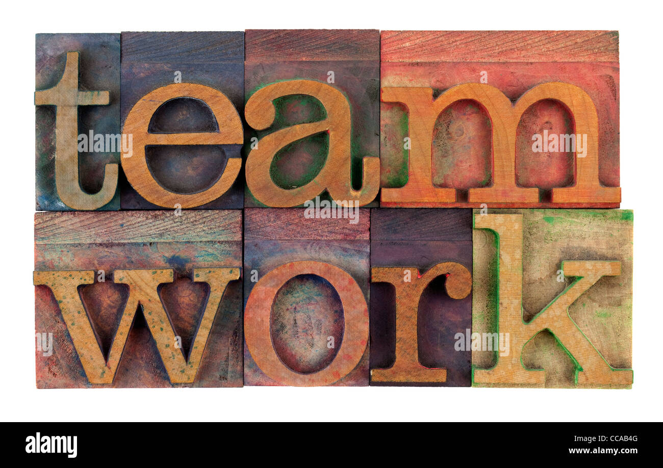 the word teamwork in vintage wooden letterpress type, stained by colorful inks, isolated on white - Stock Image