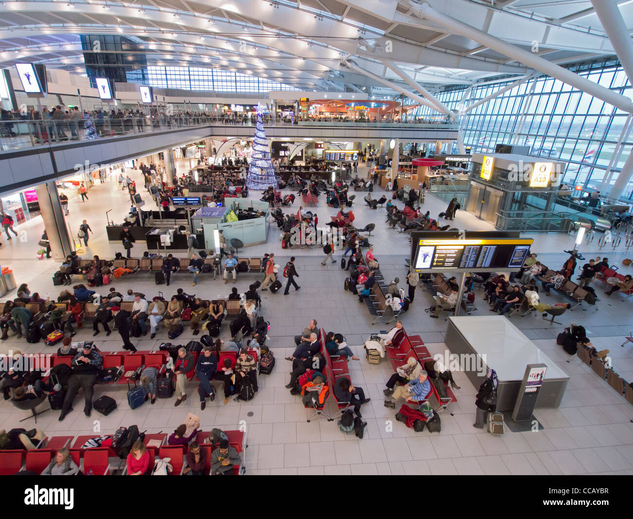 Interior of busy Terminal 5 at Heathrow Airport in London United Kingdom - Stock Image