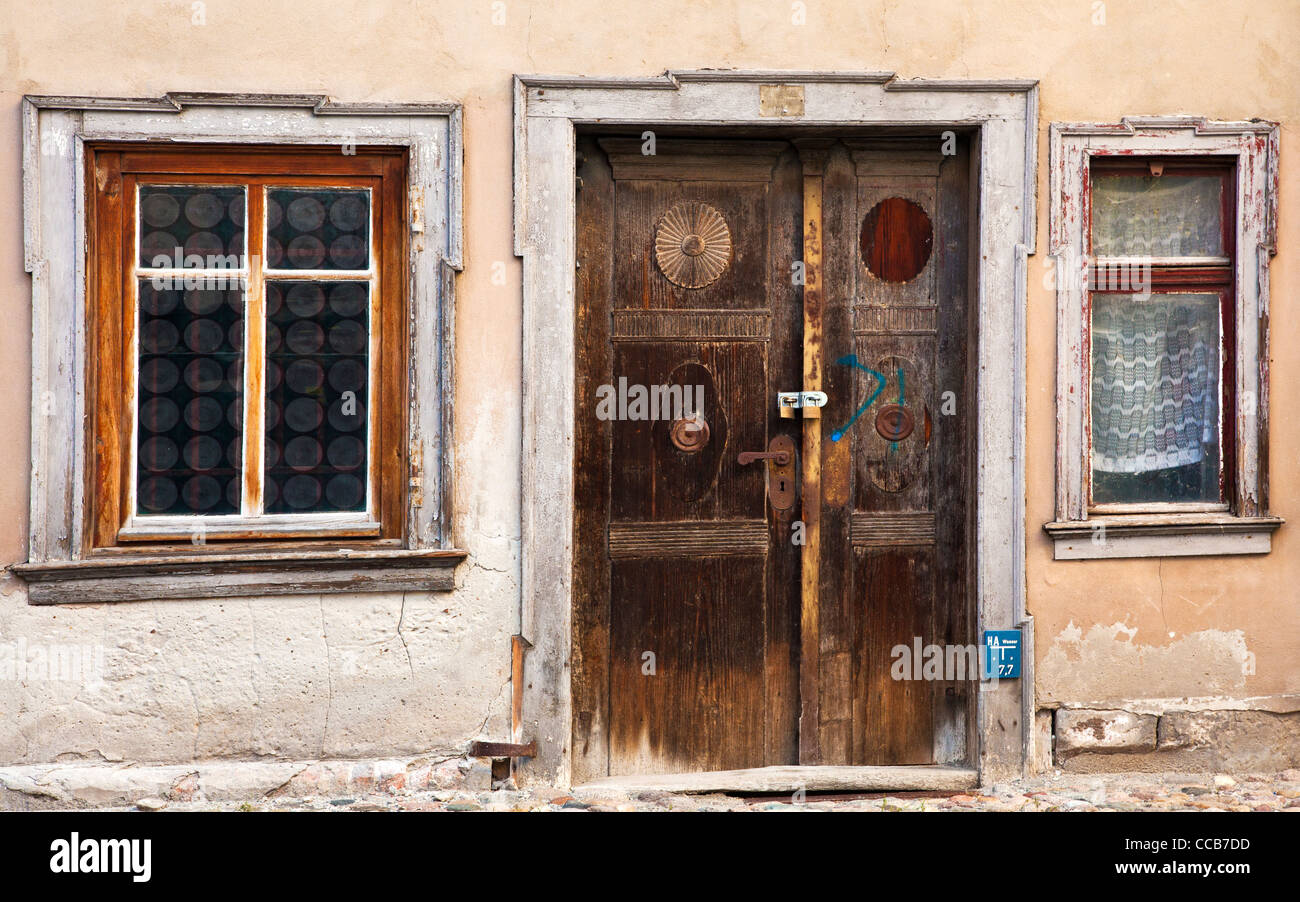 Old Wooden Front Door And Windows Of Dilapidated House In The UNESCO German  Town Of Quedlinburg In Saxony Anhalt, Germany