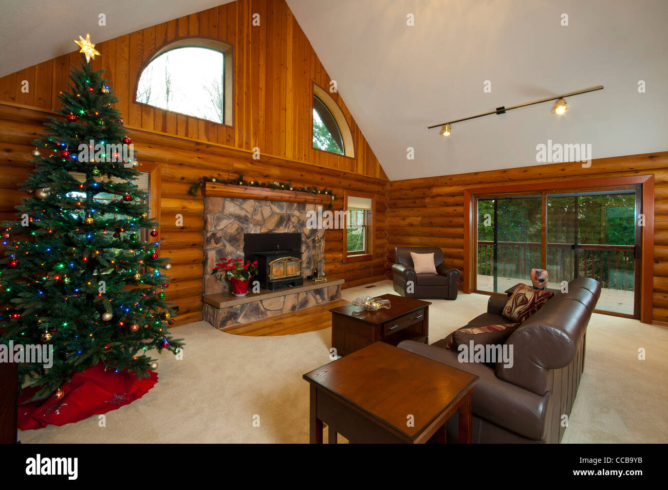 Log Cabin Living Room, Wide Angle View, Showing Fireplace, Stove, And  Sliding Glass Door To Woods Outside.