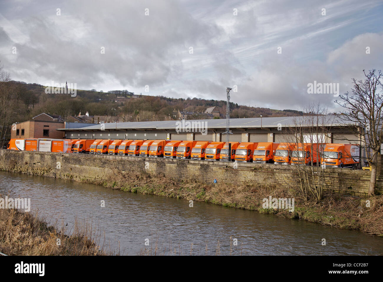The TNT freight transport depot in Ramsbottom with a line of lorries. - Stock Image