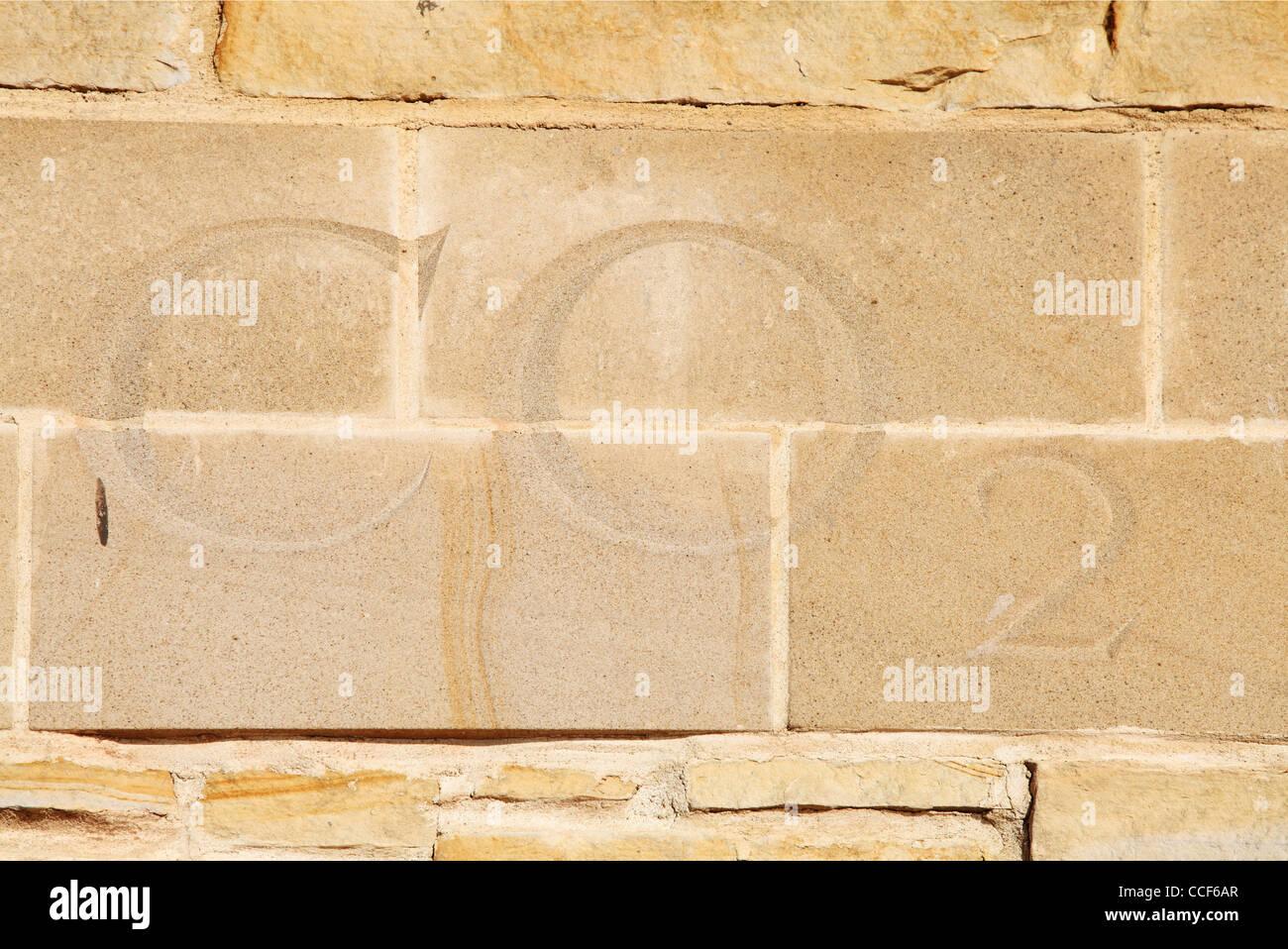 Carbon dioxide letters CO2 carved in stone old lime kilns Sunderland north east England UK - Stock Image