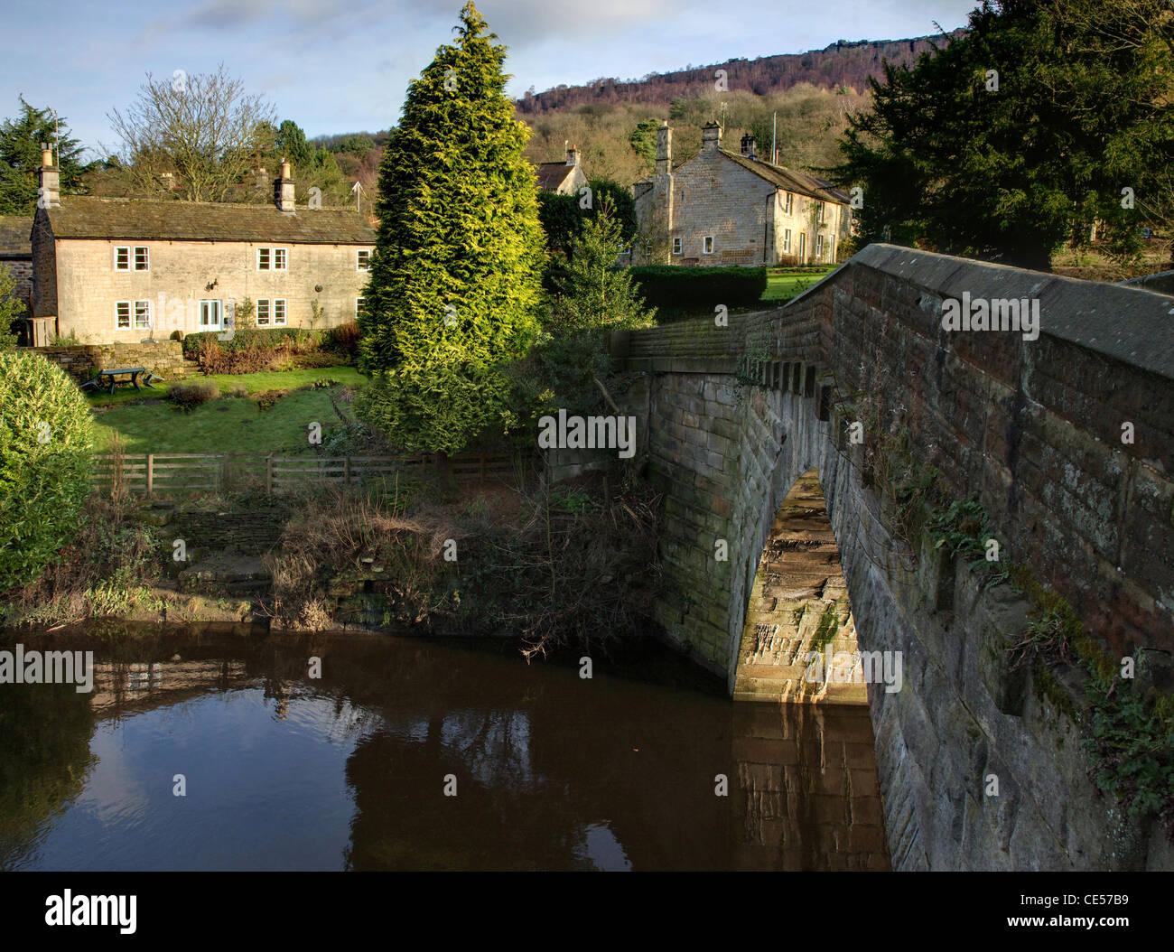Froggatt Bridge is a stone structure spanning the river Derwent at the village of Froggatt in the Derbyshire Peak - Stock Image