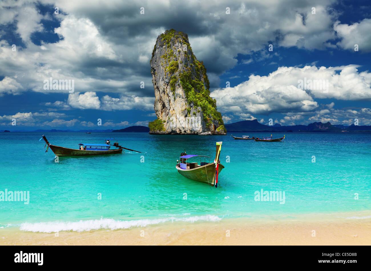Long tail boats, Tropical beach, Andaman Sea, Thailand - Stock Image