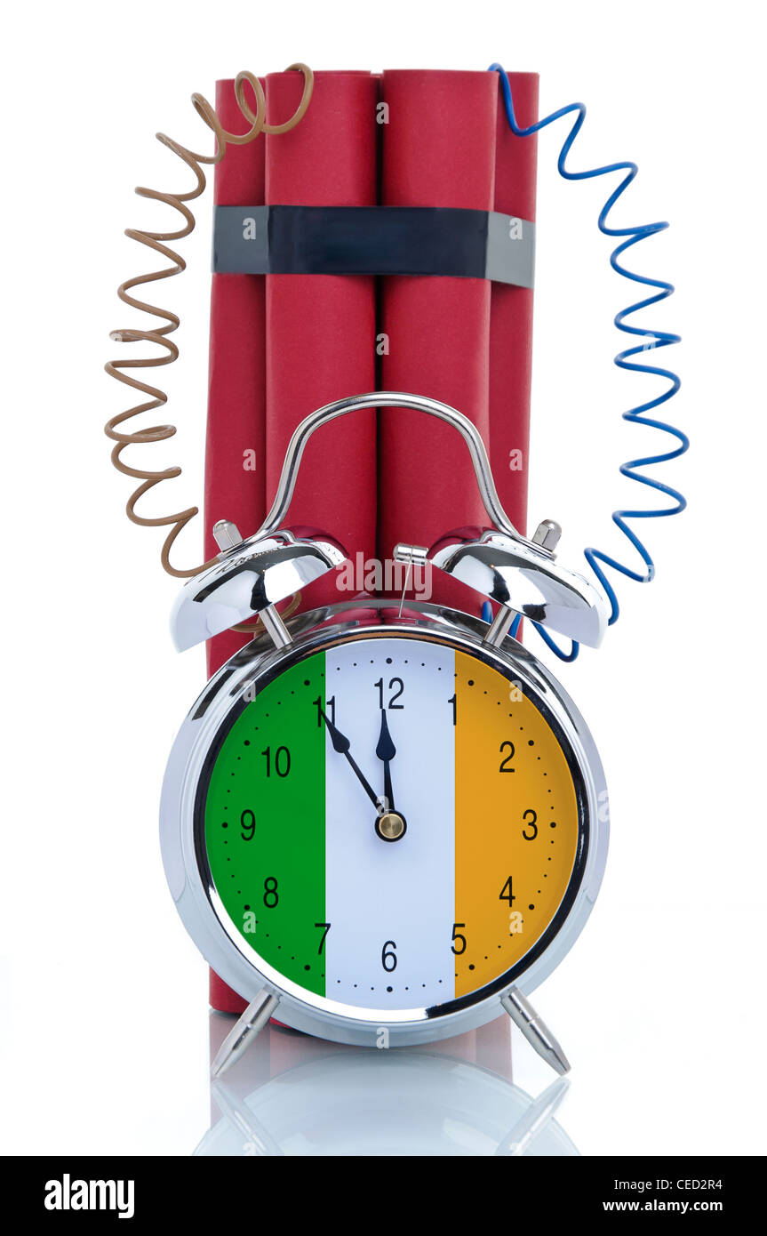 Time bomb, alarm clock attached to dynamite sticks, symbolic image, crisis in Ireland - Stock Image