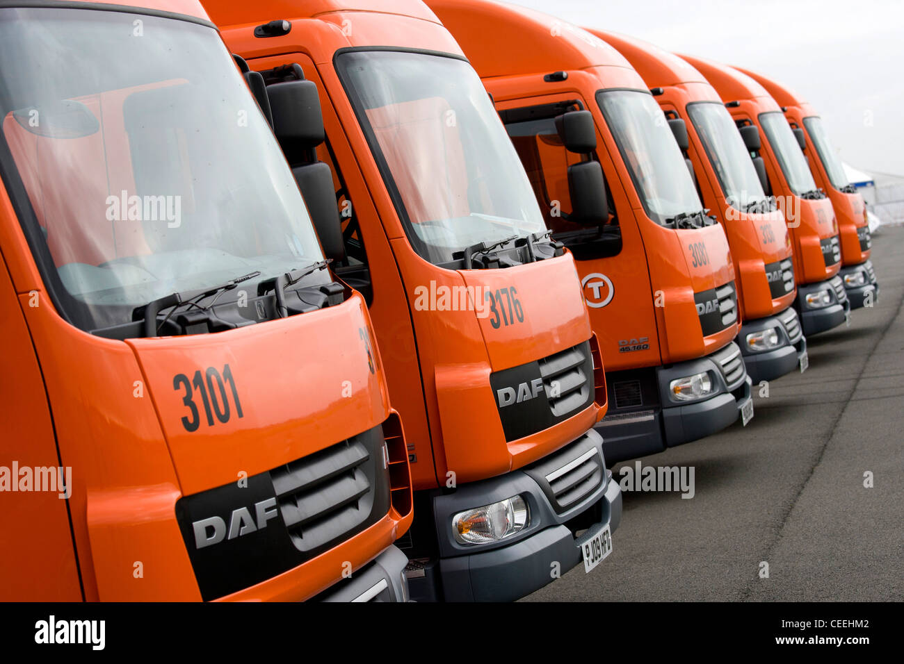 A row of DAF TNT livered trucks. - Stock Image
