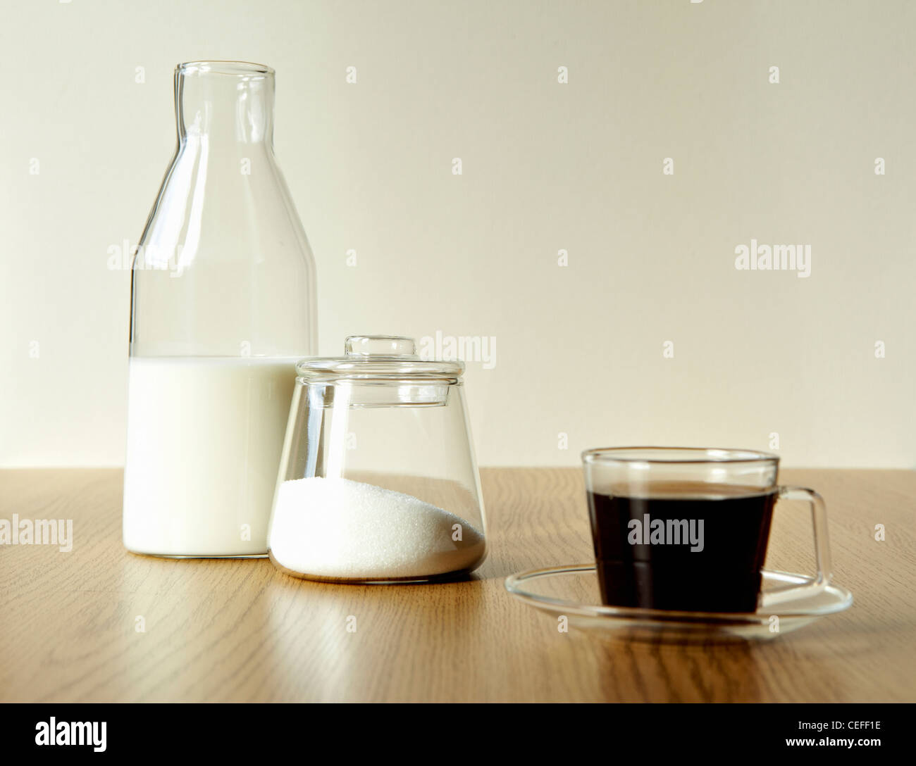 Milk and sugar with cup of tea - Stock Image