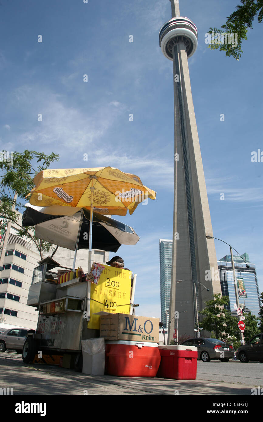 street food vendor in Toronto Canada with CNTower in background - Stock Image