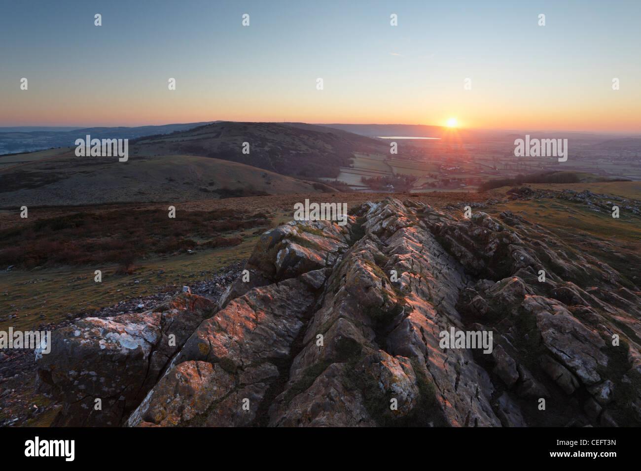 Sunrise over the Mendip Hills from Crook Peak. Somerset. England. UK. - Stock Image