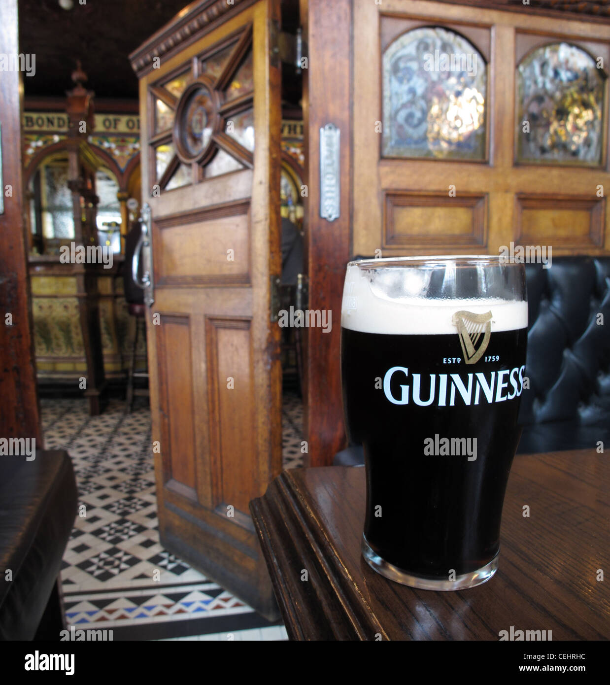 inside,crown,saloon,bar,with,pint,of,Guiness,pint,drink,beverage,Guiness,pint,cubbyhole,NT,PUb,national,trust,NI,Northern,Ireland,Northern,Ireland,Great,Victoria,Street,theatre,quarter,Europe,snug,classic,pub,public,house,victorian,gin,palace,design,old,fashioned,inside,crown,saloon,bar,Belfast,with,pint,of,Guiness,pint,drink,beverage,Guiness,pint,NT,PUb,national,trust,NI,Northern,Ireland,Northern,Ireland,Great,Victoria,Street,theatre,quarter,Europe,snug,gotonysmith,gotonysmith,Buy Pictures of,Buy Images Of