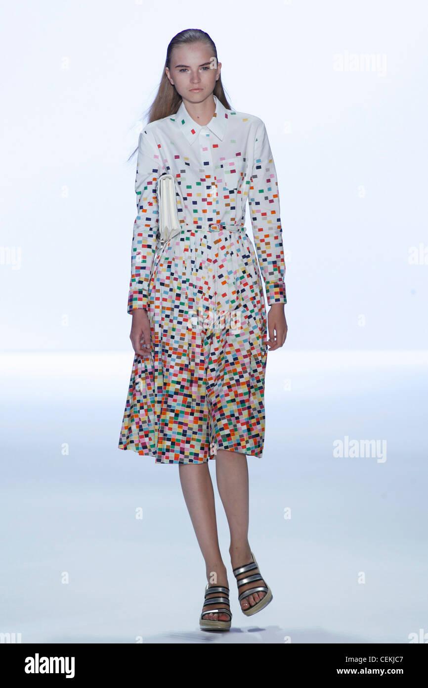 7417b018c8 Anne Klein New York Ready to Wear Spring Summer Model long blonde hair  wearing white shirt dress multicoloured mosaic pattern