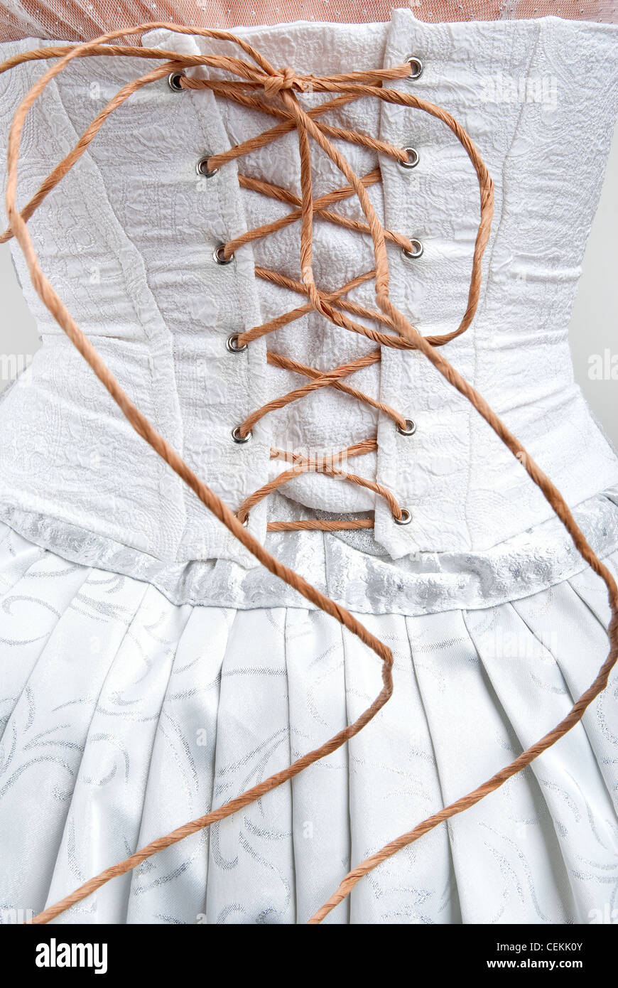 whtie corset roped with paper string - Stock Image