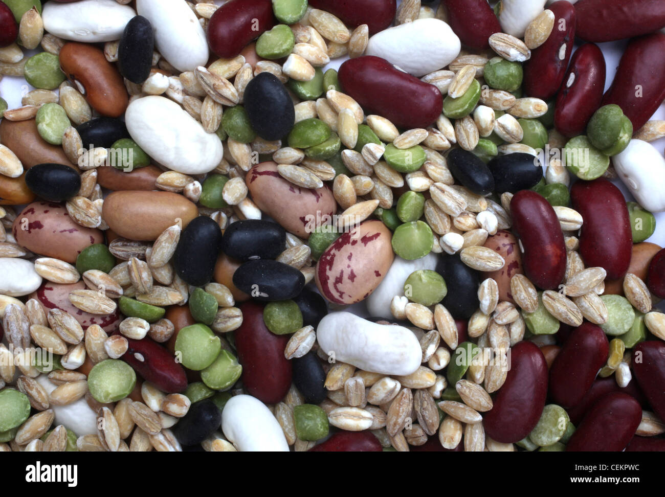 Mix of black and red string bean, lentil, green and yellow peas - Stock Image
