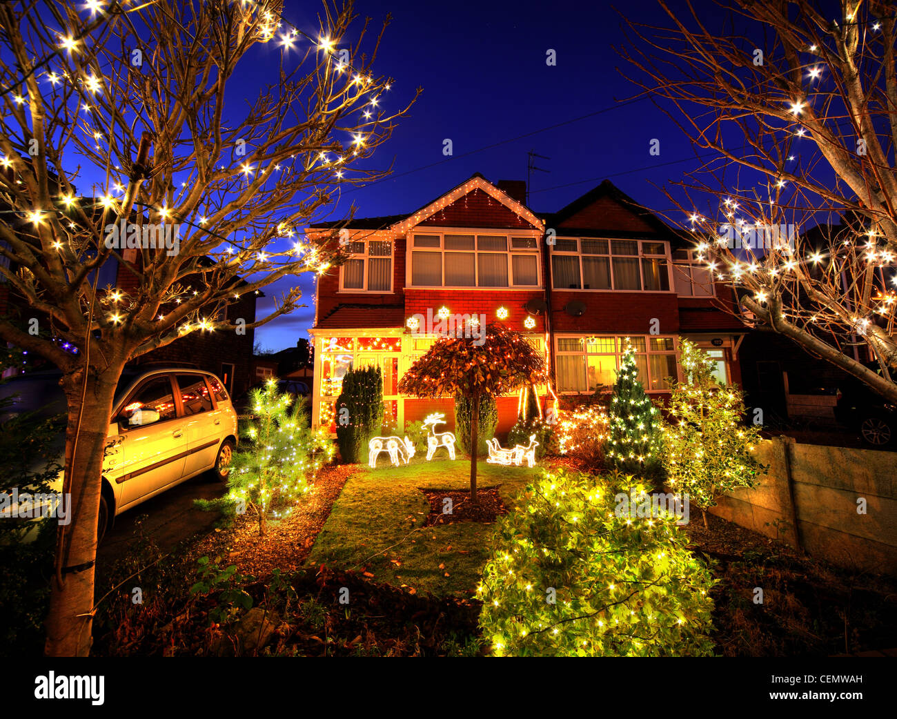 320 Padgate Lane Christmas lights Dusk,Warrington Cheshire England,UK,super,Xmas,illuminations,crazy,interesting,grass,lawn,car,DIY,do,it,yourself,Homebase,jolly,fun,humour,humourous,gotonysmith,320 Padgate Lane Christmas lights Dusk,Warrington Cheshire.jpg,gotonysmith,Warringtonians,Buy Pictures of,Buy Images Of