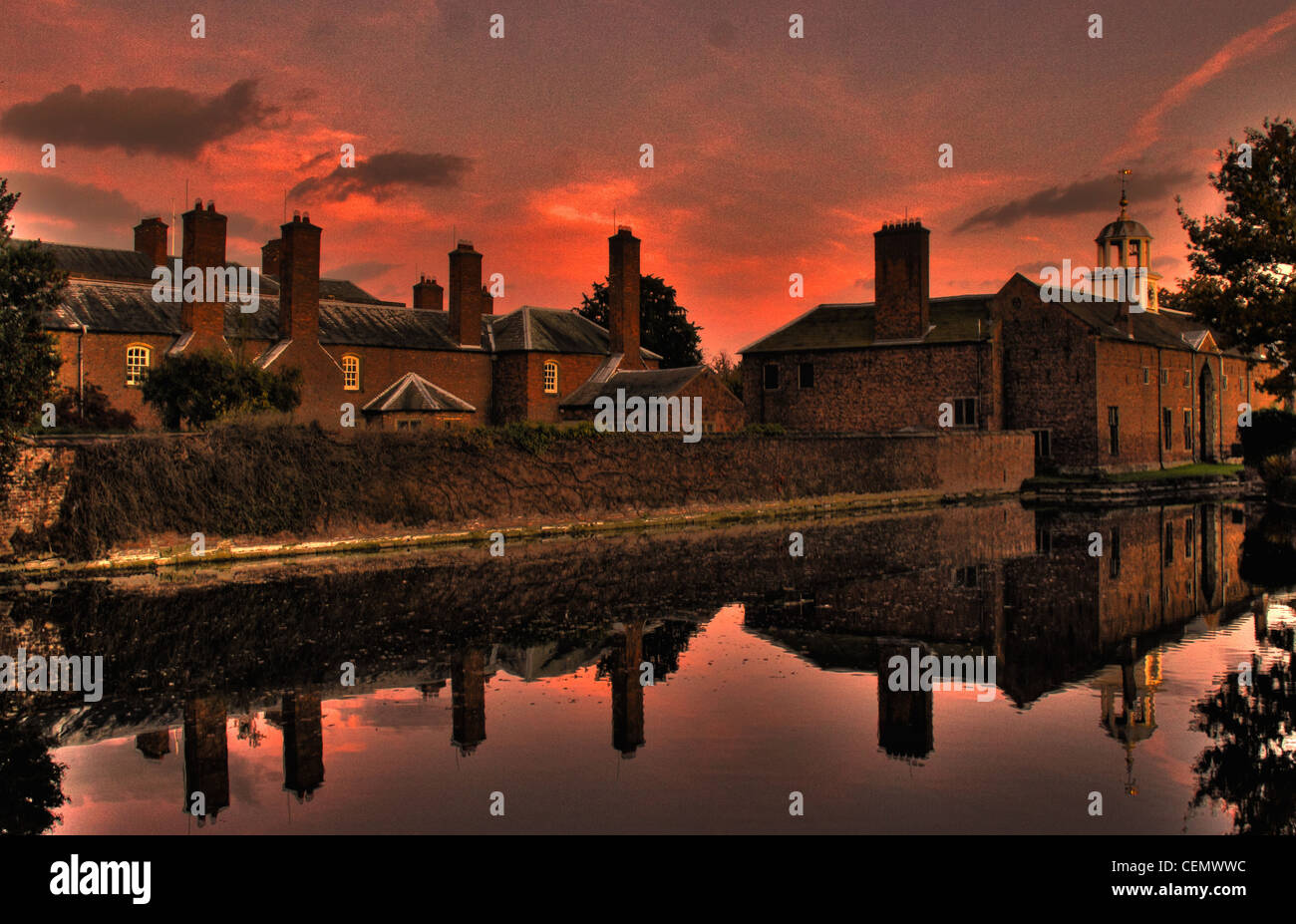 Dunham,Massey,NT,at,dusk,with,a,red,sunset,sky,This,is,National,Trust,near,Altrincham,England,UK.,Its,a,stately,home,and,garden,orange,night,sky,reflections,reflection,gotonysmith,Dunhamtown,town,Stamfords,North,west,NW,gotonysmith,Buy Pictures of,Buy Images Of,Dunham,Massey,is,a,civil,parish,in,the,Metropolitan,Borough,of,Trafford,Greater Manchester,England.,The parish includes the villages of Sinderland Green,Dunham Woodhouse and Dunham Town,along with Dunham Massey Park,formerly,the,home,of,the,last,Earl,of,Stamford,and,owned,by,the,National,Trust,since,1976.,Dunham,Massey,was,historically,in,the,county,of,Cheshire,but since 1974 has been part of Trafford Metropolitan Borough,the nearest town is Altrincham. As of the 2001 census,the parish had a population of 475.,Dunham Massey has a long history,as,reflected,in,its,45,listed,buildings.,It,was,a,locally,important,area,during,the,medieval,period,and,acted,as,the,seat,for,the,Massey,barony.,The,Georgian,hall,with the remains of a castle in its grounds,is a popular tourist attraction. Sites of Special Scientific interest,1,2