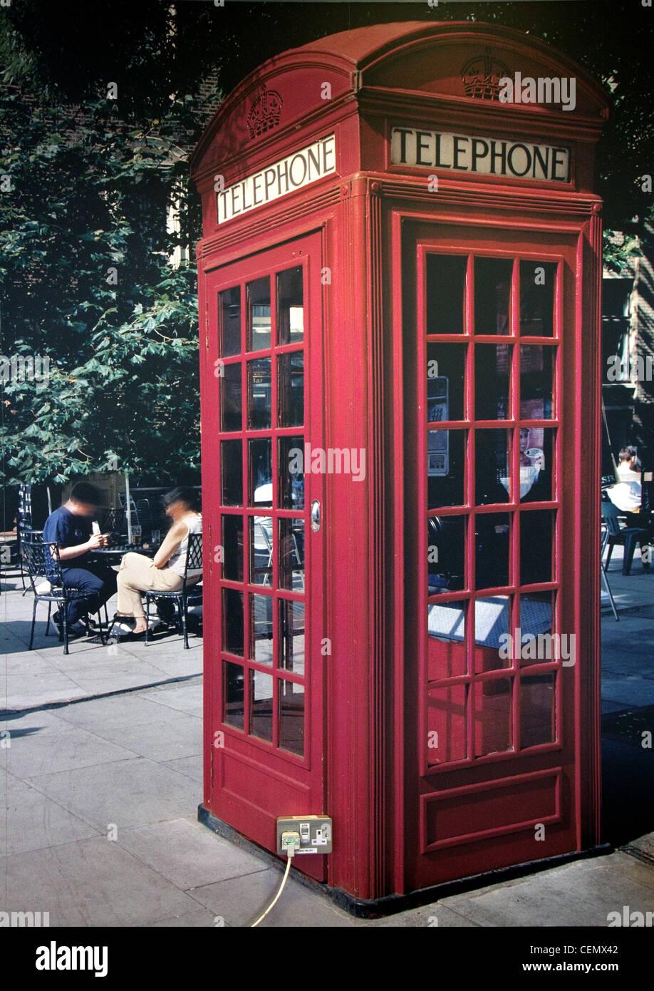 Glasgow Airport Phone box plug Poster Red Telephone Scotland,England,UK,gotonysmith,tony,smith,plug,trailing,13,amp,surreal,london,telephone,box,BT,surrealist,joke,13amp,gotonysmith,Buy Pictures of,Buy Images Of