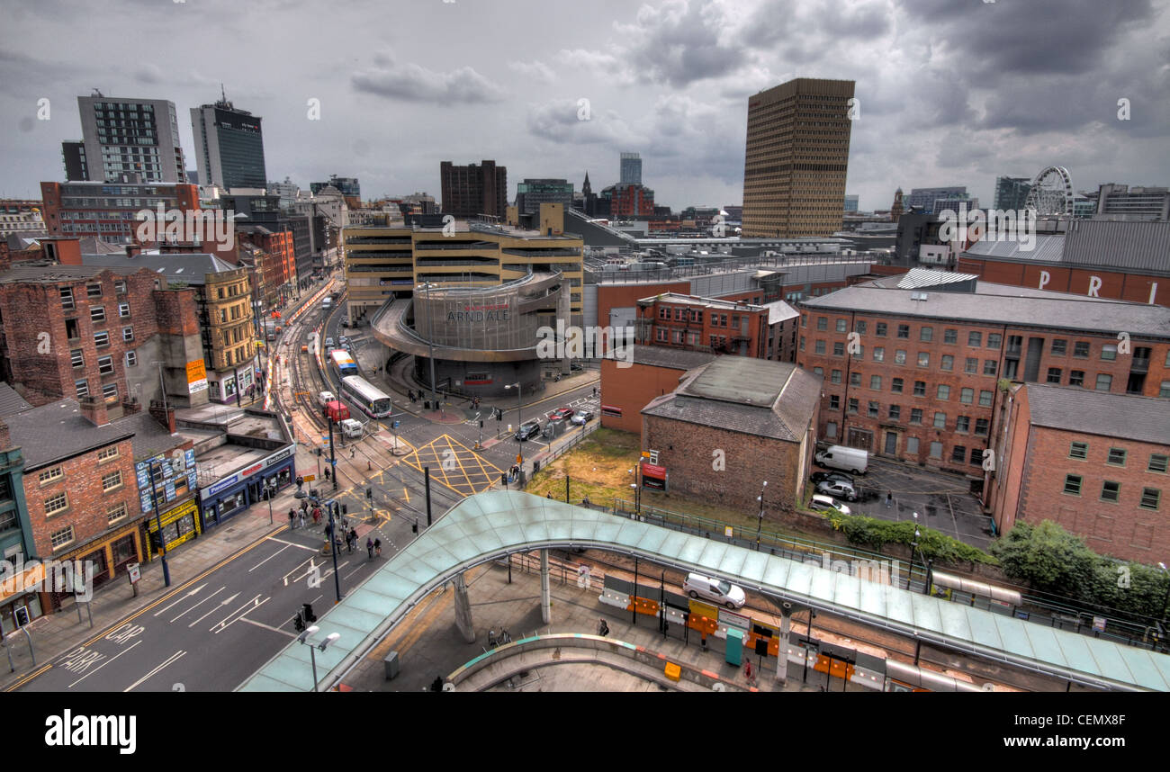 Manchester city view panorama towards Arndale shopping centre,lancs,England,UK,Northern,Quarter,MN4,MNQ,from,car,park,high,up,aerial,building,cityscape,gotonysmith,tony,smith,street,road,bus,station,printworks,dark,rainy,sky,grey,gray,gotonysmith,Buy Pictures of,Buy Images Of,The,Northern,Quarter,(,N4,or,NQ,),is,an,area,of,Manchester,City,Centre,England,generally marked out between Piccadilly,Victoria and Ancoats,and centred around Oldham Street,just off Piccadilly Gardens,Mancester A centre of alternative and bohemian culture,the,area,is,usually,considered,to,be,contained,within,Newton,Street,(borders,with,Piccadilly,Basin),Great Ancoats Street (borders with Ancoats),Back,Piccadilly,(borders,with,Piccadilly,Gardens),and,Swan,Street/High,Street,(borders,with,Shudehill/Arndale).,Popular,streets,include,Oldham,Street,Tib Street,Newton Street,Lever Street,Dale Street,Hilton,Street,and,Thomas,Street.,The,Northern,Quarter,nominated,sites,for,UNESCO,World,Heritage,Site,Status