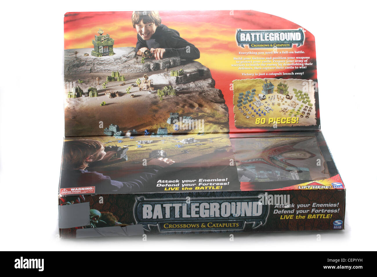battleground a favourite fighting game between two bands of soldiers, with catapults, ballistas, and canon firing - Stock Image