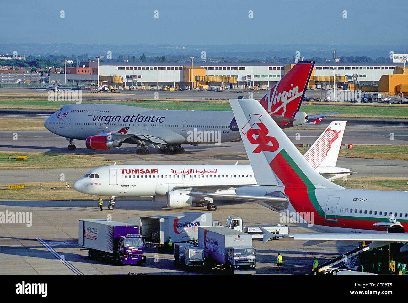 View of planes taxiing at Heathrow Airport from the former viewing terrace on top of the Queens building, due to - Stock Image