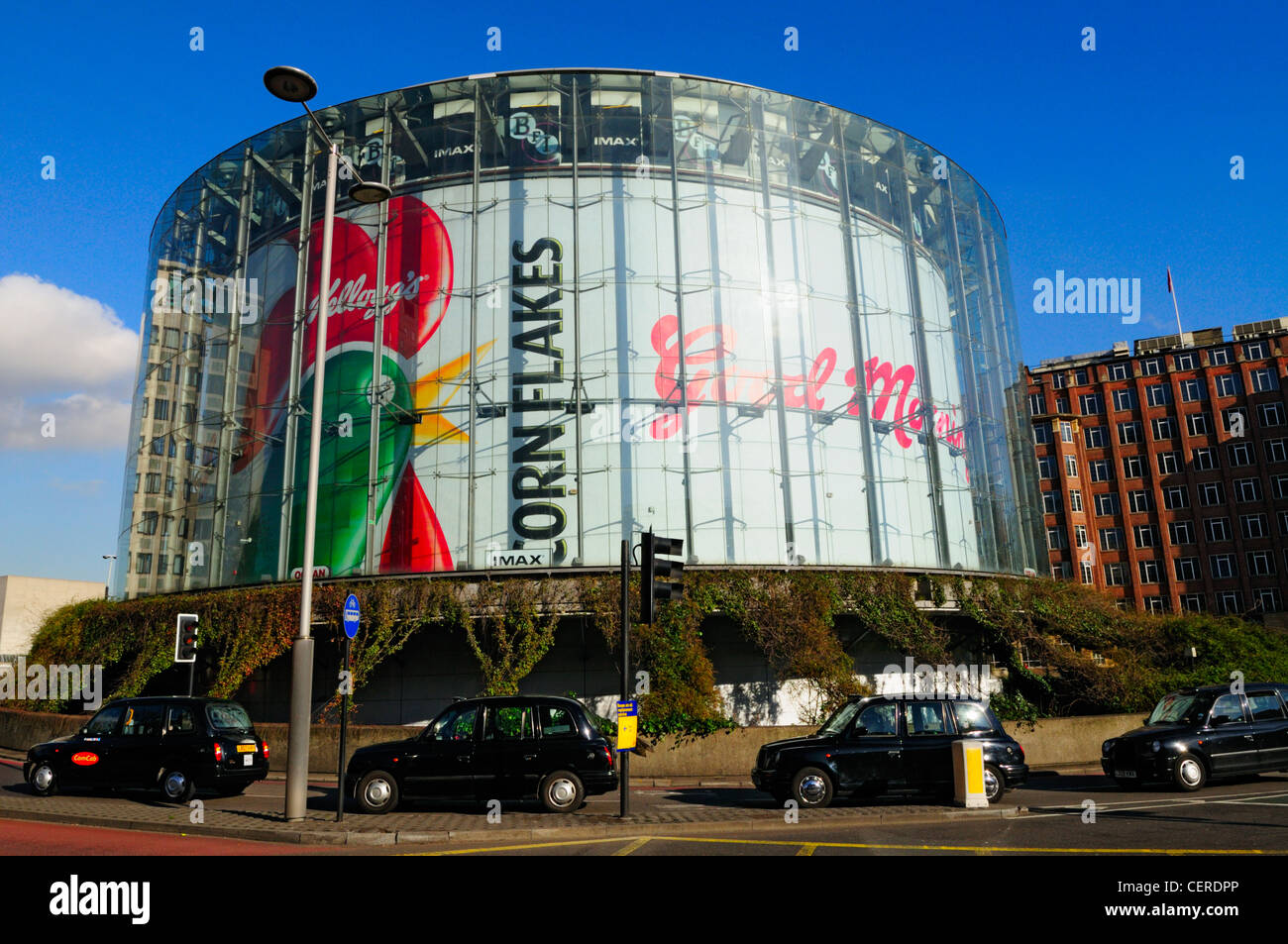 Black London taxi cabs outside the BFI IMAX Cinema, the biggest screen in Britain, at Waterloo. - Stock Image
