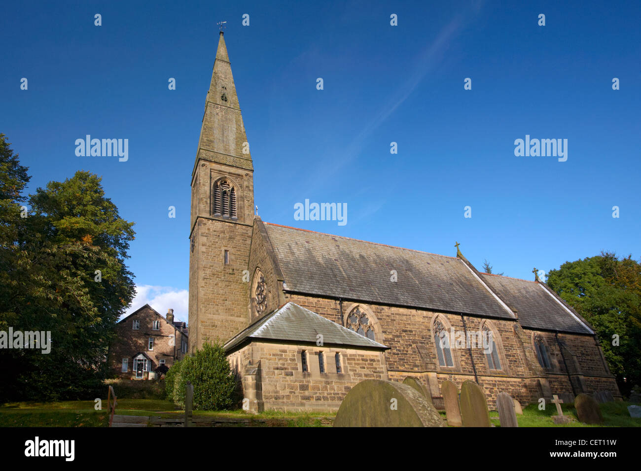An autumn blue sky over Bamford Church in the Peak District. - Stock Image