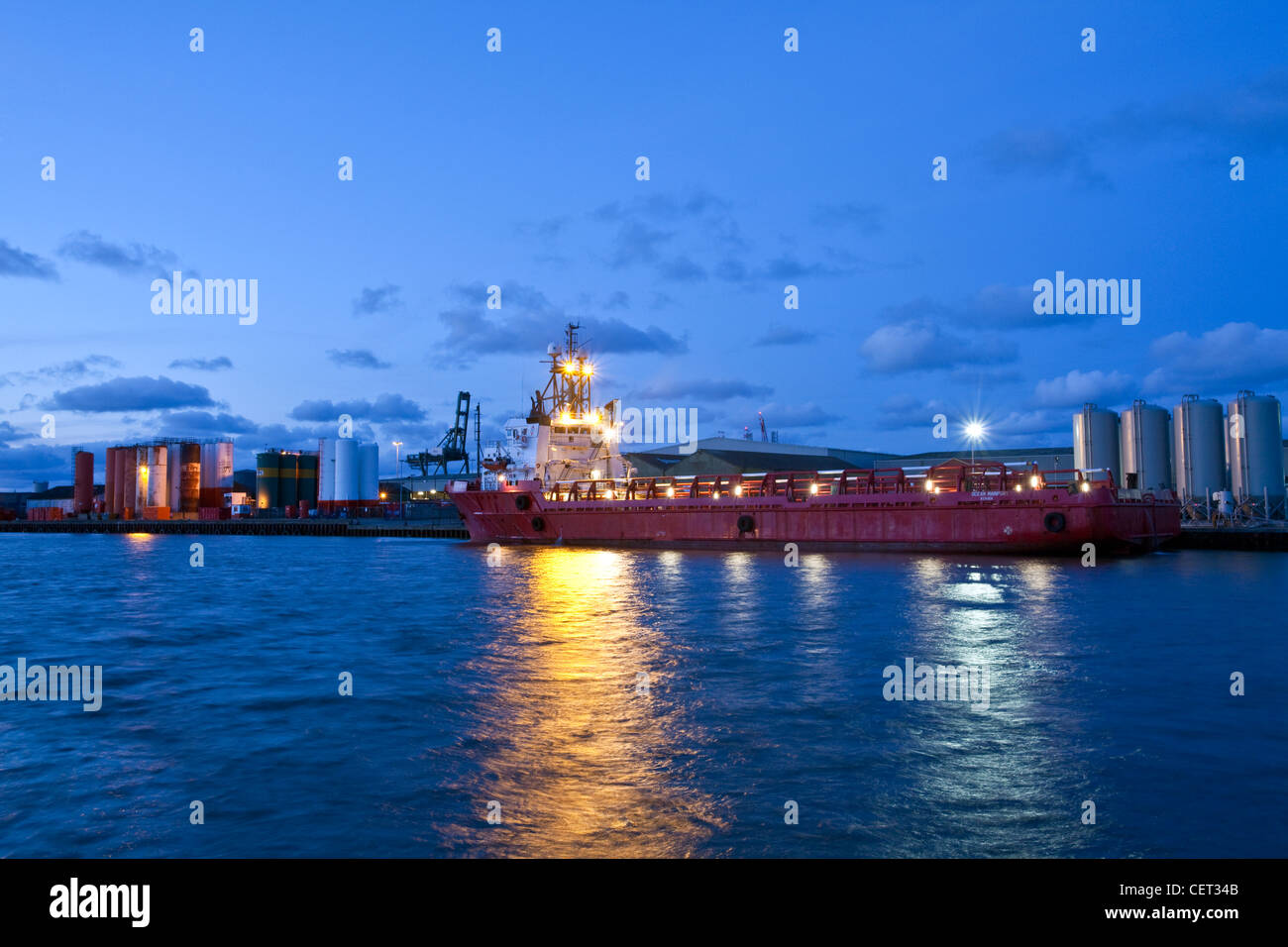 A cargo ship in the docks at Great Yarmouth. - Stock Image