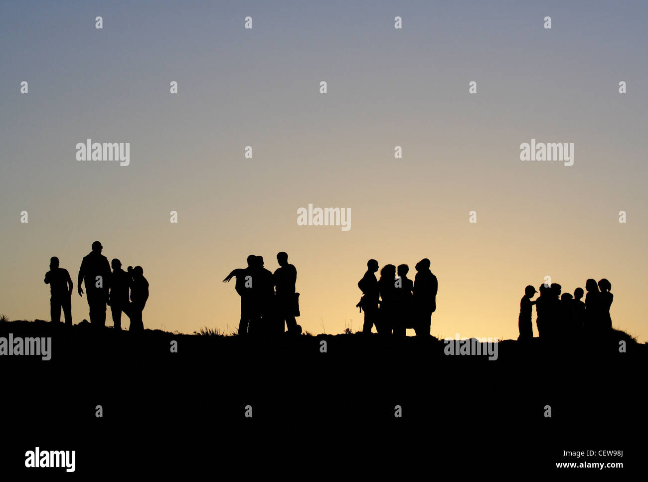 groups-of-people-in-silhouette-at-dusk-c