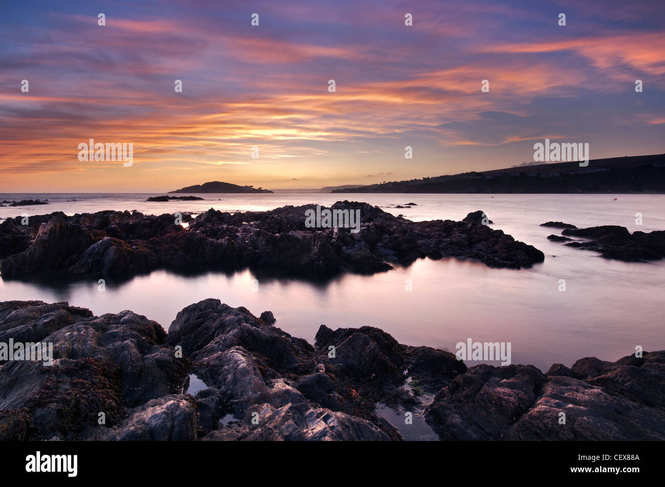 View from Bantham Beach to Burgh Island at sunset, Devon, England. - Stock Image