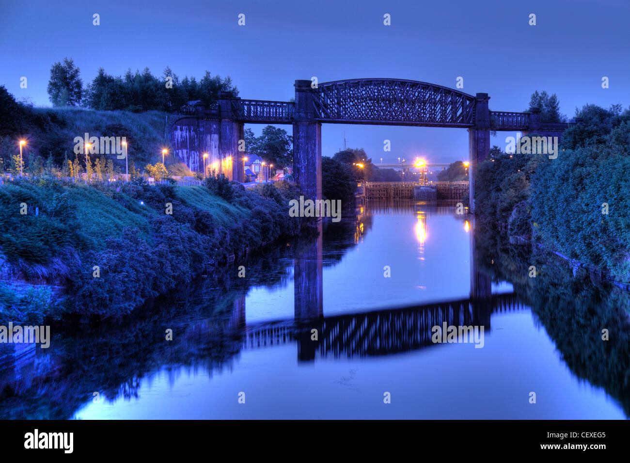 Dusk,at,the,Manchester,Ship,Canal,high,level,railway,bridge,A50,Cheshire,lines,Altrincham,Trans,Pennine,Trail,TPT,Grappenhall,from,swing,bridge,cold,frosty,night,shot,reflection,Latchford,Lock,Locks,evening,gotonysmith,Knutsford,Road,rd,gotonysmith,night,nighttime,Victorian,Engineering,Warrington,waterway,MSCC,@hotpixuk,hotpixuk,first,iconic,tourist,tour,travel,history,historic,architecture,Buy Pictures of,Buy Images Of,Victorian Engineering