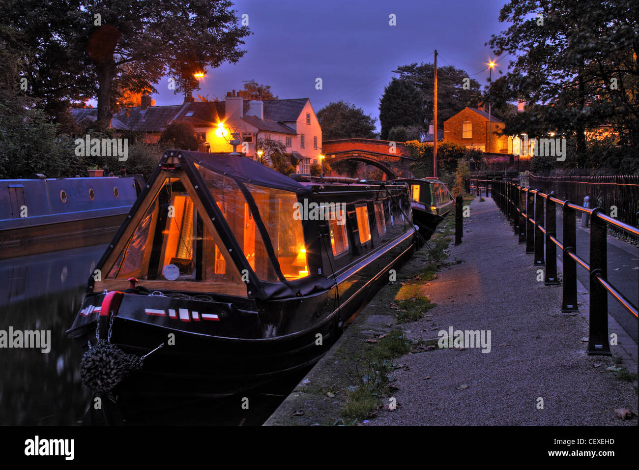 Cheshire,charming,old,olde,peaceful,tourist,place,destination,England,Warrington,UK,Gb,Great,Britain,transport,boat,boats,barges,barge,longboat,butty,gotonysmith,night,shot,nightshot,evening,warm,glow,of,lights,romantic,lit,by,candle,candlelight,light,candles,narrowboat,basin,Bridgewater Canal,canal,basin,narrowboats narrow boats,gotonysmith,canal basin,Buy Pictures of,Buy Images Of