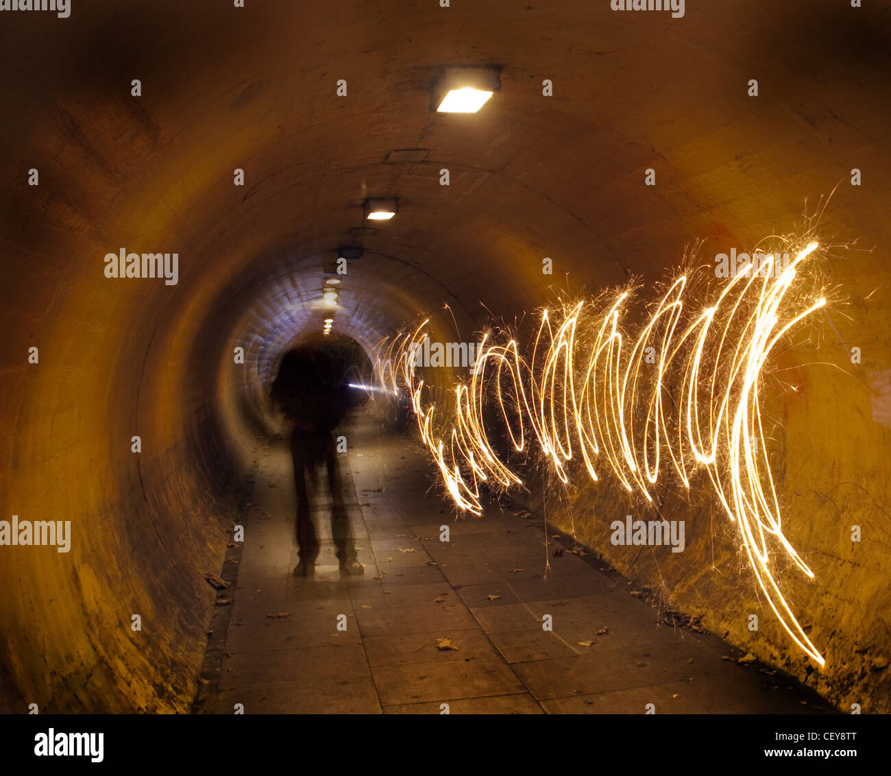 gotonysmith,A,man,in,a,tunnel,at,night,tunnelvision,vision,underground,under,ground,lights,shaking,a,sparkler,swimming,with,light,night,dusk,time,book,cover,path,man,person,figure,walk,walking,london,firework,of,light,painting,with,light,Latchford,London Underground,painting with light,Warrington,Cheshire,A50,road,bridge,gotonysmith,Buy Pictures of,Buy Images Of