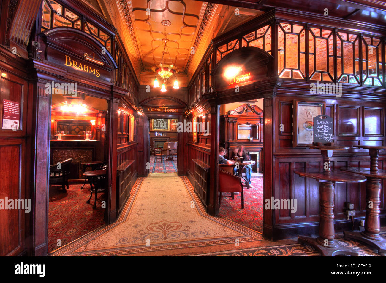 Interior,Phillharmonic,Pub,Liverpool,Philharmonic,gin,palace,ginpalace,decorated,decorated,mersey,Hope,St,Street,Liverpool,Canning,Georgian,Quarter,Rodney,Street,conservation,area,grade,2,II,listed,public,house,the Phil Brahms Liszt Robert Cain bar area architecture,pubs,bar,The Phil,Hope,Street,Quarter,William,Hope,Philharmonic,Hall,Victorian,design,Walter,W,Thomas,The,interior,is,decorated,in,musical,themes,that,relate,to,the,nearby,concert,hall.,These,decorations,are,executed,on,repoussé,copper,panels,designed,by,Bare,and,by,Thomas,Huson,plasterwork by C. J. Allen,mosaics,and,items,in,mahogany,and,glass.,Two,of,the,smaller,rooms,are,entitled,Brahms,and,Liszt.,Of,particular,interest,to,visitors,is,the,high,quality,of,the,gentlemens,urinals,constructed in,Buy,Pictures,of,Buy,Images,Of,Liverpool,Pub,Liverpool Pubs,tourist,tourism,tour,pub,bars,@hotpixuk,Phillharmonic,Philharmonic pub liverpool pub,Liverpool Pubs,pubs,bars,bar,history,historic,Hope Street Quarter,a particularly attractive roseate marble architectural gems,gotonysmith,,,,,,,