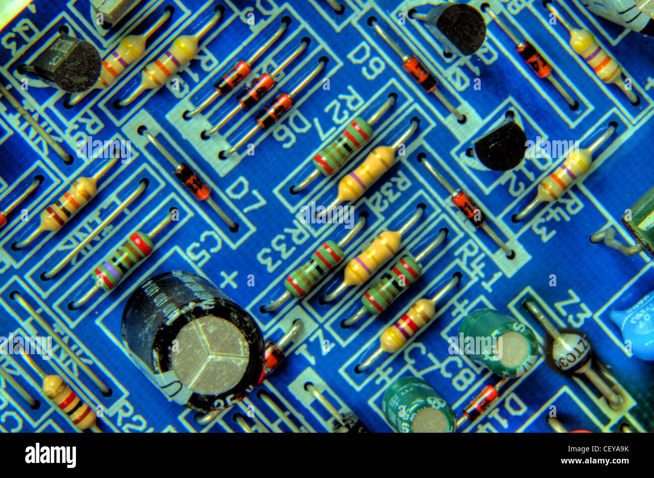 Electronics,Electronic,Electric,Blue,Printed,Circuit,Board,with,resistors,capacitor and transistors,from,Bosch,Worcester,central,heating,boiler,components,component,technology,high,tech,hitech,hi-tech,gotonysmith,integrated,PCB,tech,printed circuit board,A,printed,circuit,board,or PCB,is,used,to,mechanically,support,and,electrically,connect,electronic,components,using,conductive,pathways,tracks,or,signal,traces,etched,from,copper,sheets,laminated,onto,a,non-conductive,substrate,gotonysmith,Buy Pictures of,Buy Images Of